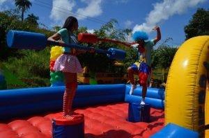 Kids having fun jousting.
